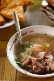 Soto. a soup dish, served with meat (chicken / beef), rice, tomato, vermicelli, herbs, etc. Yum!