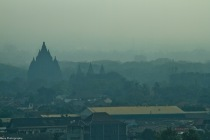 prambanan temple shot from afar. lots of editing applied to get the temple more visible.