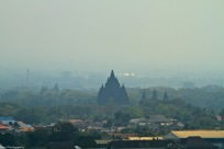 This is Prambanan temple seen from afar, after the sun is high. the three little temple on the right is where tourist goes at night to watch traditional dance shows