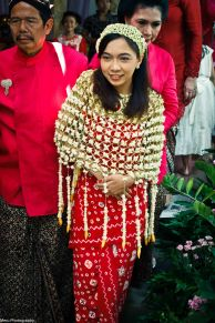 the red cloth is handprinted batik. They always use red batik for wedding shower. Never any other color