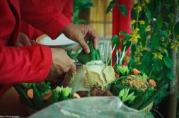 While Dinda is drying herself up and changing, Mum start to cut the 'Tumpeng'. Tumpeng is the cone-shaped rice